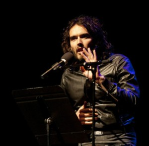 Russell Brand performing